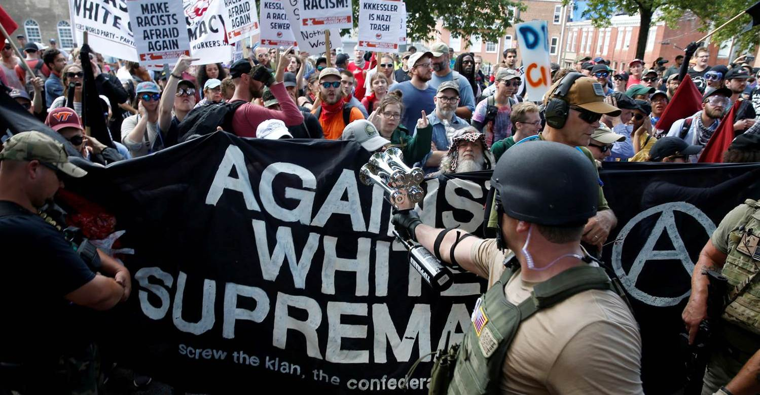Members of white nationalists are met by a group of counter-protesters in Charlottesville, Virginia, Aug. 12, 2017. Joshua Roberts / Reuters
